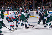 KELOWNA, CANADA - FEBRUARY 2: Nolan Foote #29 of the Kelowna Rockets digs the puck out from between the legs of Reece Vitelli #26 of the Everett Silvertips after the face off on FEBRUARY 2, 2018 at Prospera Place in Kelowna, British Columbia, Canada.  (Photo by Marissa Baecker/Shoot the Breeze)  *** Local Caption ***