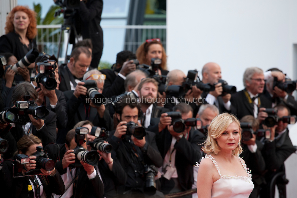 Actress Kirsten Dunst with photographers at the gala screening for the film Loving at the 69th Cannes Film Festival, Monday 16th May 2016, Cannes, France. Photography: Doreen Kennedy
