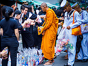 13 OCTOBER - BANGKOK, THAILAND: People make merit by giving alms to Buddhist monks on the first anniversary of the death of Bhumibol Adulyadej, the Late King of Thailand. About 199 monks from 14 Buddhist temples in Bangkok participated in the mass merit making at Siriraj Hospital to mark the anniversary of the revered King's death. He will be cremated on 26 October 2017.  PHOTO BY JACK KURTZ
