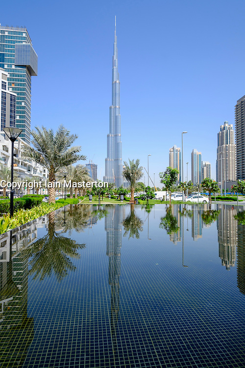 Burj Khalifa tower reflected in pond in Dubai United Arab Emirates