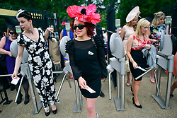 © London News Pictures. 20/06/2013. Ascot, UK. The gates are opened. Ladies Day on day three of Royal Ascot at Ascot racecourse in Berkshire, on June 20, 2013. The 5 day showcase event, which is one of the highlights of the racing calendar, has been held at the famous Berkshire course since 1711 and tradition is a hallmark of the meeting. Top hats and tails remain compulsory in parts of the course.  Photo credit : Stephen Simpson/LNP