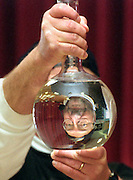 "( 3 COLS. X 8"" )  David J. Rogowski photo for news runs 3/13/01.   Steve Tomecek, a geologist and science educator called the ""Dirtmeister"" looks through a beaker during his program at Tesago Elementary School on the Shenendehowa campus in Clifton Park Monday March 12, 2001.  Tomecek showed students how to perform visual scientific experiments."