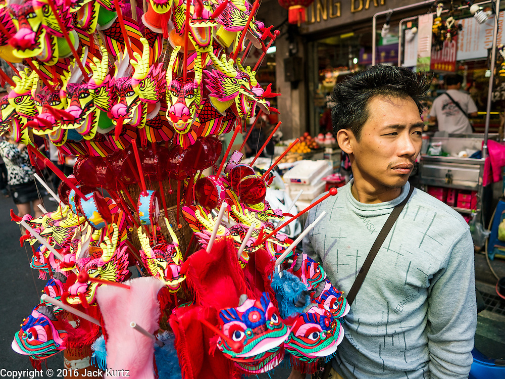 """07 FEBRUARY 2016 - BANGKOK, THAILAND: Selling Chinese New Year toys on Yaowart Road in Bangkok's Chinatown.  Chinese New Year, also called Lunar New Year or Tet (in Vietnamese communities) starts Monday February 8. The coming year will be the """"Year of the Monkey."""" Thailand has the largest overseas Chinese population in the world; about 14 percent of Thais are of Chinese ancestry and some Chinese holidays, especially Chinese New Year, are widely celebrated in Thailand.        PHOTO BY JACK KURTZ"""