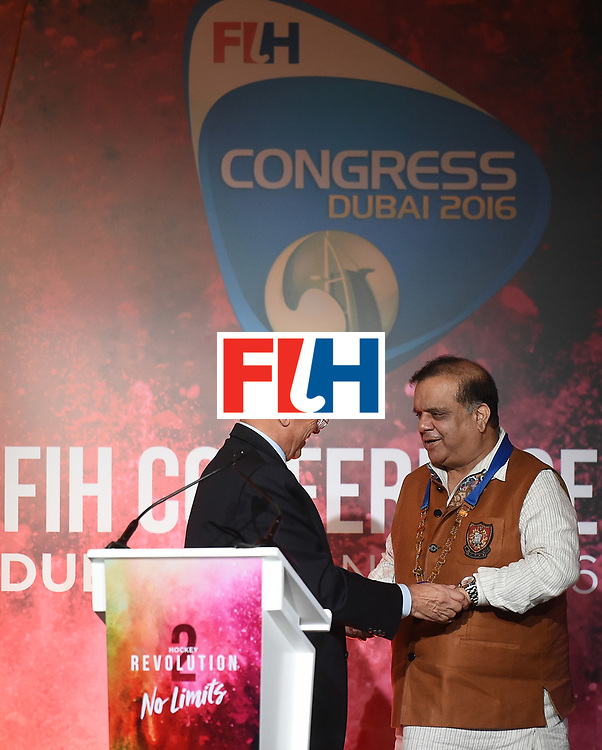 DUBAI, UNITED ARAB EMIRATES - NOVEMBER 12:  Newly appointed President of The International Hockey Federation, Dr Narinder Batra (R) is congratulated by Leandro Negre (L) during the 45th FIH Congress on November 12, 2016 in Dubai, United Arab Emirates.  (Photo by Tom Dulat/Getty Images)