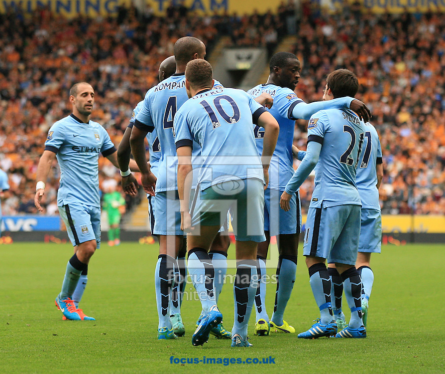 Edin Dzeko (10) of Manchester City celebrates his teams 3rd goal of the game with his team mates  during the Barclays Premier League match at KC Stadium, Hull<br /> Picture by Richard Gould/Focus Images Ltd +44 7855 403186<br /> 27/09/2014