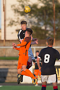 Dundee's trialist central defender outjumps Dundee United's Logan Chalmers - Dundee under 20s v Dundee United in the SPFL Development League at Links Park, Montrose<br /> <br />  - &copy; David Young - www.davidyoungphoto.co.uk - email: davidyoungphoto@gmail.com