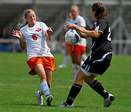 5 JUNE 2010 -- FENTON, Mo. -- Platte County soccer player Breann Rolofson (8) and Notre Dame de Sion's Rachel Fenimore (22) battle for control of the ball during the third-place game at the MSHSAA Class 2 girls' soccer tournament Saturday, June 5, 2010 at the Anheuser-Busch Center in Fenton, Mo. Photo © copyright 2010 by Sid Hastings.