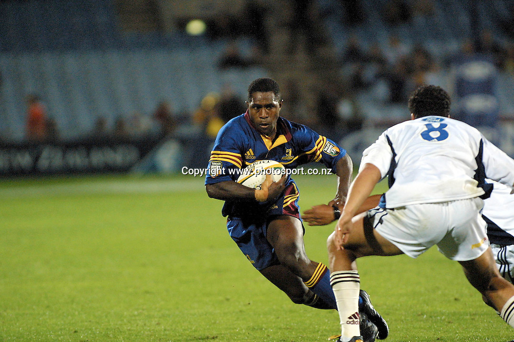 Aisea Tuilevu attempts to step around Ron Cribb during the rugby union Super 12 match between the Highlanders and Blues, 23 February, 2001 at Carisbrook, Dunedin. Photo: Dean Treml/PHOTSPOR *** Local Caption ***