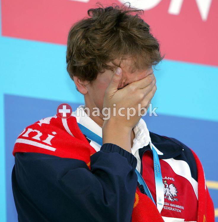 Poland's Otylia Jedrzejczak is overcome with emotion on the victory stand after winning the gold medal in world record time of 2:05.61  at the FINA World Championships in Montreal, Canada Thursday 28 July, 2005. (Photo by Patrick B. Kraemer / MAGICPBK)