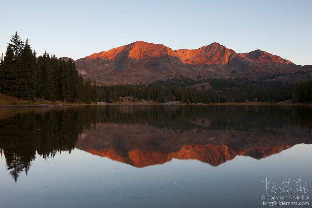 Ruby Peak (left) and Mount Owen are reflected in Lake Irwin, located near Crested Butte, Colorado, at sunrise. Located in Gunnison County, Ruby Peak has an elevation of 12641 feet (3853 meters); Mount Owen is slightly taller with an elevation of 13058 feet (3980 meters). Lake Irwrin, also known as Lake Brennand, was formed in 1963 with the completion of the Lake Brennand Dam.