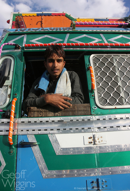 Driver of Tata truck on the road to Leh in the Himalayas Ladakh, northern India