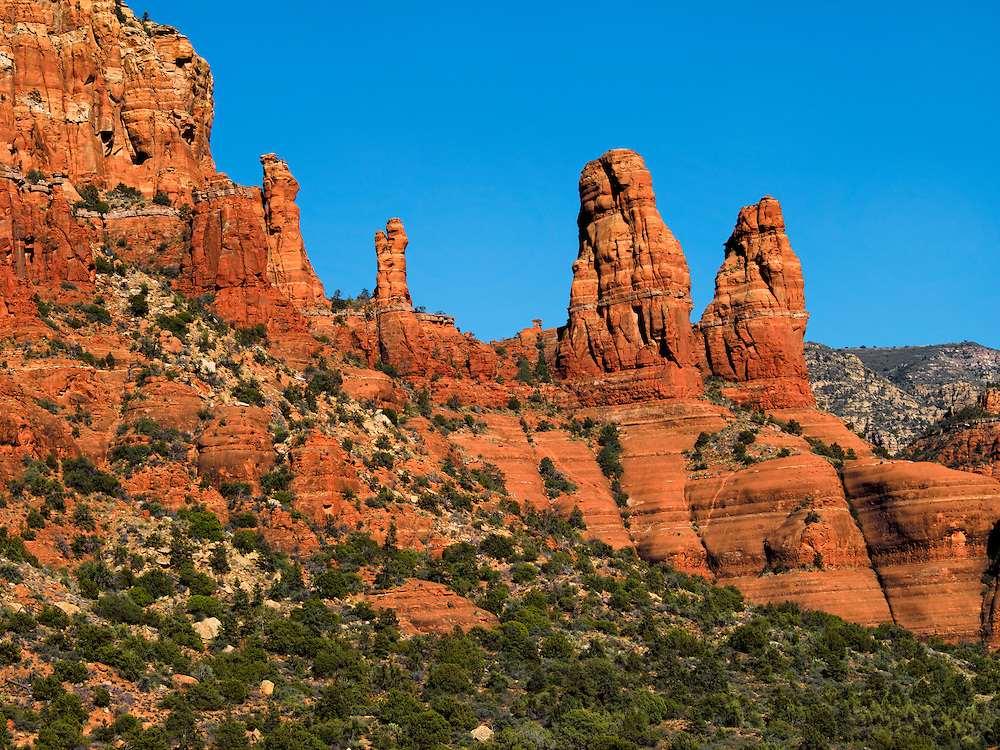 The Two Sisters rise along the edge of the Two Buttes red rock formation, Sedona Arizona April 2014.