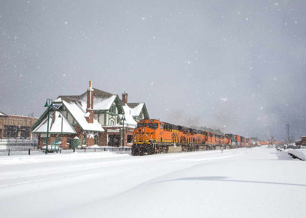 The last wave of snow falls over the college town of Flagstaff, Arizona as CSX to BNSF interchanged stack train rumbles up the grade to the 7,359' foot high summit of the Arizona Divide along the BNSF Seligman Subdivision. Jan. 24, 2017