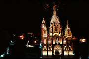 Birds making light streaks in a night shot around the top spire of the Gothic Cathedral (built 13th to 15th Century) in Barcelona, Spain.