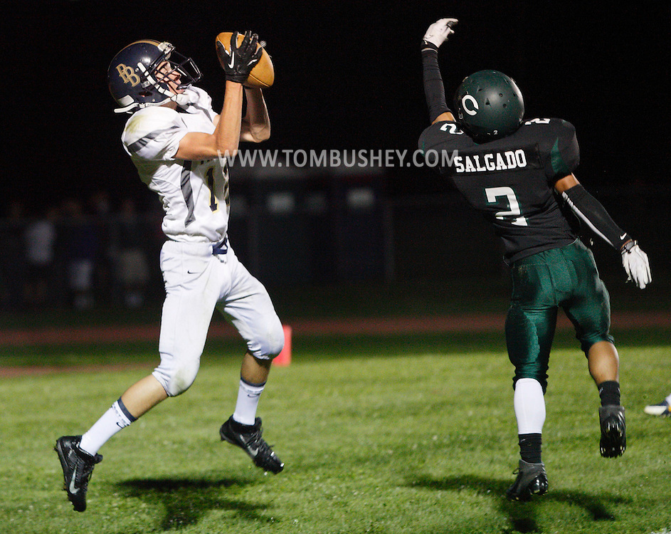 Pine Bush's Artie Econom, left, catches a touchdown pass as Cornwall's Andres Salgado defends during a football game in Cornwall on Friday, Sept. 6, 2013.