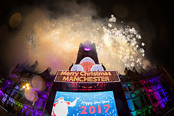 © Licensed to London News Pictures . 01/01/2017 . Manchester , UK . Thousands gather as Manchester celebrates the start of 2017 , with a fireworks display in front of Manchester Town Hall in Albert Square . Photo credit : Joel Goodman/LNP