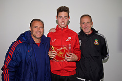 NEWPORT, WALES - Sunday, May 22, 2016: Kyle Jones is presented with his cap by former Wales players Clayton Blackmore [L] and Joey Jones [R] during the Football Association of Wales' National Coaches Conference 2016 at Dragon Park FAW National Development Centre. (Pic by David Rawcliffe/Propaganda)