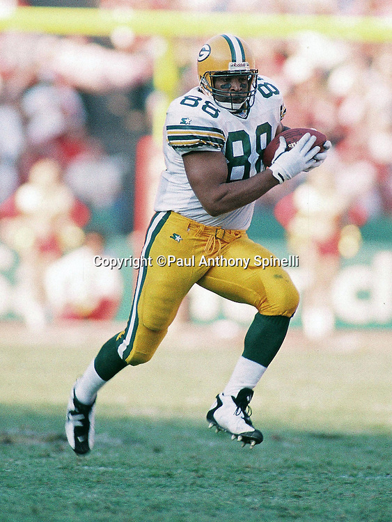 Green Bay Packers tight end Keith Jackson (88) runs with the ball after catching a pass during the NFL NFC Divisional Playoff football game against the San Francisco 49ers on Jan. 6, 1996 in San Francisco. The Packers won the game 27-17. (©Paul Anthony Spinelli)