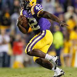 November 13, 2010; Baton Rouge, LA, USA; LSU Tigers running back Michael Ford (42) runs with the ball during the second half against the Louisiana Monroe Warhawks at Tiger Stadium. LSU defeated Louisiana-Monroe 51-0.  Mandatory Credit: Derick E. Hingle