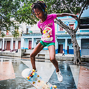A young, talented skateboarder shows off her skills.