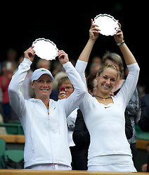 LONDON, ENGLAND - Saturday, July 2, 2011: Sabine Lisicki (GER) R and Samantha Stosur (AUS) L with the runners-up trophies after losing the Ladies' Doubles Final match on day twelve of the Wimbledon Lawn Tennis Championships at the All England Lawn Tennis and Croquet Club. (Pic by David Rawcliffe/Propaganda)