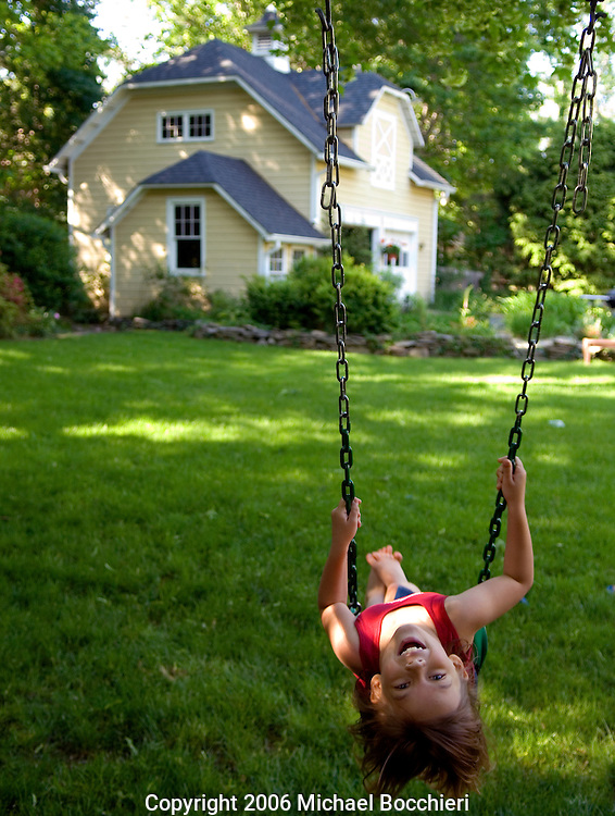 RIDGEWOOD, NJ - May 22:  A girl plays on a swing in a backyard at a home  on May 22, 2006 in RIDGEWOOD, NJ.  (Photo by Michael Bocchieri/Bocchieri Archive)