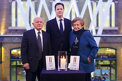 © licensed to London News Pictures. London, UK 27/01/2014. Holocaust survivors Ben Helfgott MBE and Sabina Miller lighting a candle with Deputy Prime minister Nick Clegg to commemorate the Holocaust and genocide victims on Holocaust Memorial Day at King's Cross Station. Photo credit: Tolga Akmen/LNP