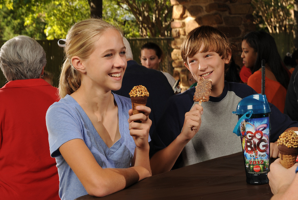 Enjoying an ice cream cone at Six Flags Over Texas as part of a corporate lifestyle photo shoot.