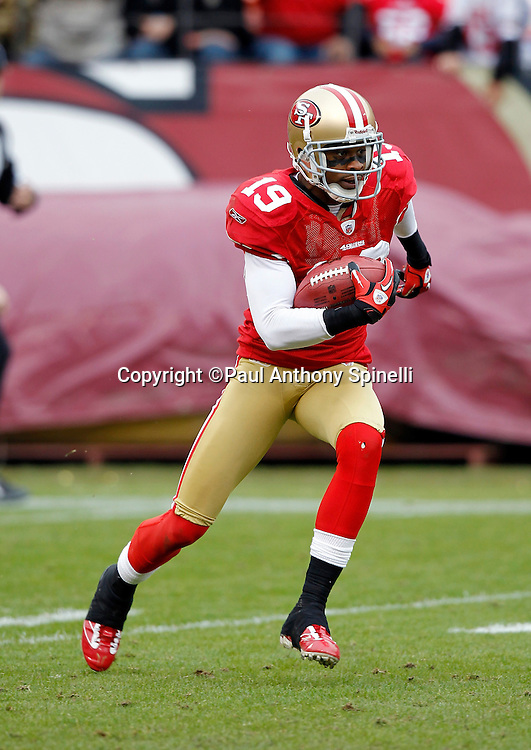 San Francisco 49ers kick returner Ted Ginn (19) returns a second quarter kick during the NFL week 17 football game against the Arizona Cardinals on Sunday, January 2, 2011 in San Francisco, California. The 49ers won the game 38-7. (©Paul Anthony Spinelli)
