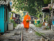 04 FEBRUARY 2015 - BANGKOK, THAILAND:  A Buddhist monk on his morning alms rounds in a working class neighborhood of Bangkok. After months of relative calm following the May 2014 coup, tensions are increasing in Bangkok. The military backed junta has threatened to crack down on anyone who opposes the government. Relations with the United States have deteriorated after Daniel Russel, the US Assistant Secretary of State for Asian and Pacific Affairs, said that normalization of relations between Thailand and the US would depend on the restoration of a credible democratically elected government in Thailand.   PHOTO BY JACK KURTZ