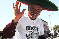 "Ice cream man Alfredo Colin Guzman was in a great mood for Sunday's ""El Grito"" celebration in Salinas marking September 16th's anniversary of Mexico's independence from Spain. The annual fiesta, which occupies East Alisal Street between Wood and Sanborn, brimmed as usual with booths selling patriotic souvenirs and all manner of food and drink. Local businesses and nonprofits manned booths with information about health and community programs, while traditional ""bandas"" filled the afternoon with dance music and good cheer."