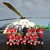 FREE TO USE PHOTOGRAPH....30.10.15<br /> Scotland's Charity Air Ambulance (SCAA) unveiled it's new helicopter at Perth airport this morning a EC135 T2i (pictured) which replaces the Bolkow 105 helicopter which is retiring from service. The new helicopter will increase speed, range, endurance and payload, allow SCAA to fly at night and in cloud. Pictured from left, Mark Tynan, Craig McDonald, David Craig SCAA Chief Exec, Chief Pilot Russell Myles, Julia Barnes, John Salmond and Lead Paramedic John Pritchard.<br /> Front row from left, Paul Gowans, Phillip Campbell, Alan Finlayson and Chris Darlington<br /> for further info please contact Maureen Young on 07778 779000<br /> Picture by Graeme Hart.<br /> Copyright Perthshire Picture Agency<br /> Tel: 01738 623350  Mobile: 07990 594431