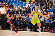 Erin Phillips of the Dallas Wings drives to the basket against the Connecticut Sun during a WNBA preseason game in Arlington, Texas on May 8, 2016.  (Cooper Neill for The New York Times)