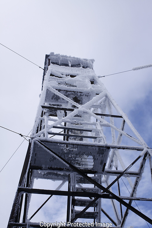 Fire Tower at top of Glastonbury Mountain, Shaftsbury, VT. The tower's metal frame and steps are all encrusted in 1-2 inches of ice and frost,after a recent messy storm.