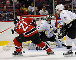 Mar 14, 2007; East Rutherford, NJ, USA;  Pittsburgh Penguins goalie Jocelyn Thibault (41) slides across the crease to stop a New Jersey Devils defenseman Brad Lukowich (21) shot during the third period at Continental Airlines Arena in East Rutherford, NJ.  Thibault earned a 3-0 shutout win.  Mandatory Credit: Ed Mulholland-US PRESSWIRE Copyright © 2007 Ed Mulholland