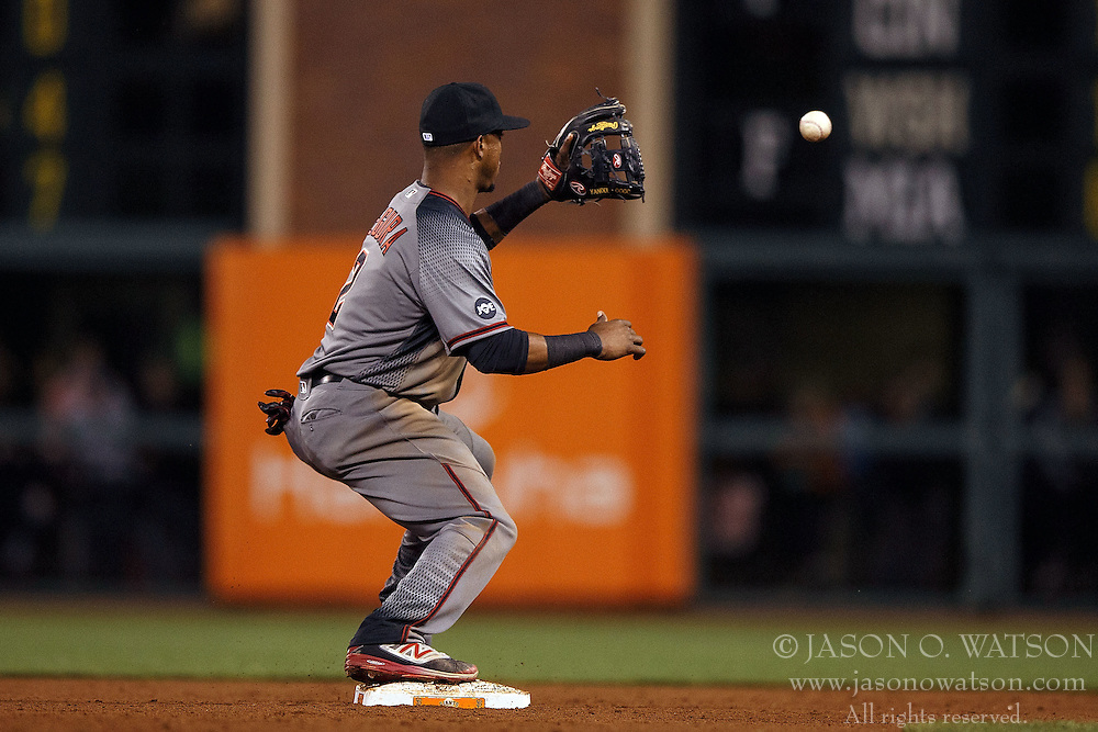 SAN FRANCISCO, CA - APRIL 18: Jean Segura #2 of the Arizona Diamondbacks fields a throw at second base for a force out against the San Francisco Giants during the eleventh inning at AT&T Park on April 18, 2016 in San Francisco, California. The Arizona Diamondbacks defeated the San Francisco Giants 9-7 in 11 innings.  (Photo by Jason O. Watson/Getty Images) *** Local Caption *** Jean Segura