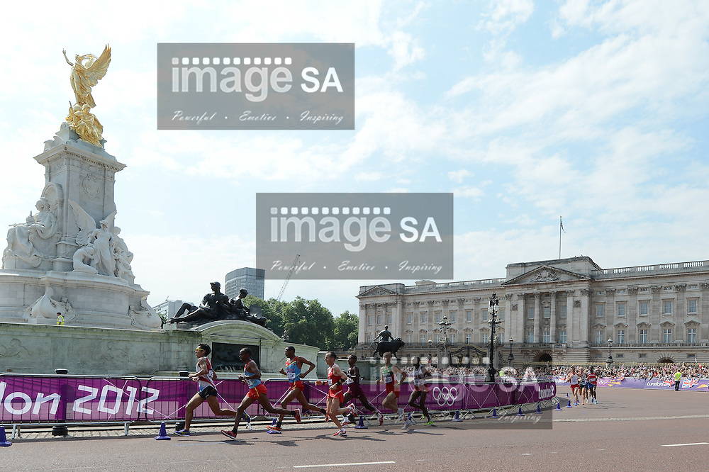 LONDON, ENGLAND - AUGUST 12, athletes run around the Victoria Memorial and in front of Buckingham Palace during the men's marathon in The Mall, on August 12, 2012 in London, England.Photo by Roger Sedres / Gallo Images