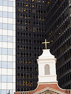 Tower of the Church of Our Lady of the Rosary admid the downtown office towers near Battery Park, New York City