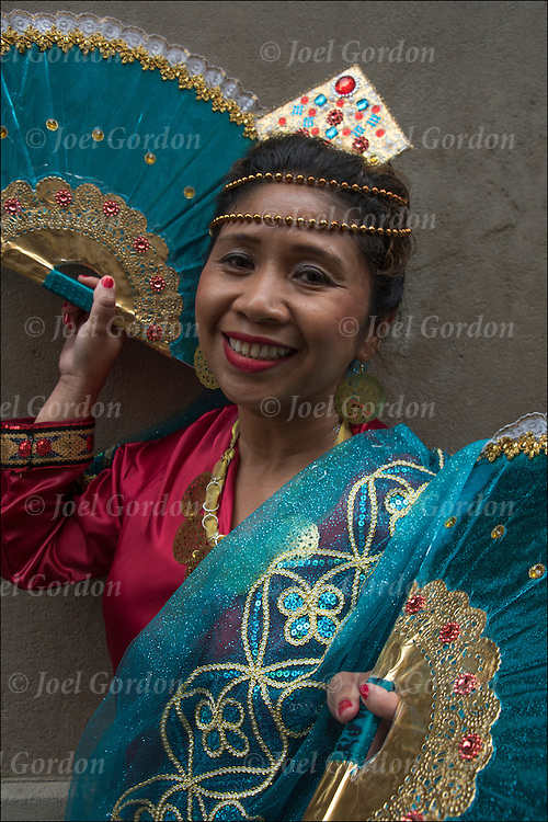 Ethnic Pride for Filipinos in the Philippine Day Day Parade. She is  wearing Carnival regalia, fans and headdress.
