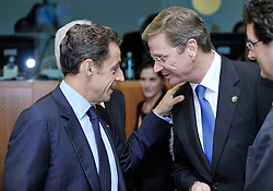 "Nicolas Sarkozy, France's president, left, speaks with Guido Westerwelle, Germany's new foreign minister, during the European Union Summit at the EU headquarters in Brussels, Belgium, on Thursday, Oct. 29, 2009. European Union leaders are set for ""very difficult"" talks to overcome the Czech Republic's resistance to a new governing treaty designed to strengthen the EU's influence in world affairs, Reinfeldt said. (Photo © Jock Fistick)"