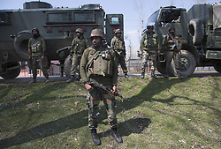 SRINAGAR, March 22, 2019 - Srinagar, Kashmir, India - Indian army troopers stand guard near the site of a gunfight at Hajin village of Bandipora district, about 40 km north of Srinagar, the summer capital of Indian-controlled Kashmir. Six militants and a 12-year-old boy were killed in three separate fierce gunfights in restive Indian-controlled Kashmir, officials said Friday. (Credit Image: © Xinhua via ZUMA Wire)