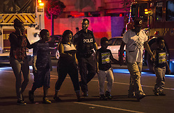 Police escort civilians away from the scene of a mass casualty incident in Toronto, ON, Canada on Sunday, July 22, 2018. A young woman has been killed and 13 others injured in a shooting incident in Toronto, Canadian police say. The Sunday night shooting happened in the Danforth and Logan avenues area. The gunman died in an exchange of fire. Among those injured is a young girl, described as in a critical condition. Police are appealing for witnesses. Photo by Frank Gunn/ABACAPRESS.COM