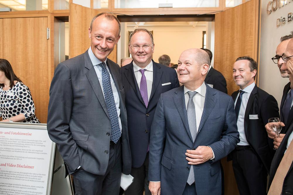 """18 JUN 2018, BERLIN/GERMANY:<br /> Friedrich Merz (L), Vorsitzender des Aufsichtsrates BlackRock Asset Management Deutschland AG, Harald Christ (M), Wirtschaftsforum der SPD, Olaf Scholz (R), SPD, Bundesfinanzminister, Veranstaltung Wirtschaftsforum der SPD: """"Finanzplatz Deutschland 2030 - Vision, Strategie, Massnahmen!"""", Haus der Commerzbank<br /> IMAGE: 20180618-01-036"""
