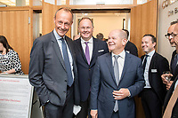 18 JUN 2018, BERLIN/GERMANY:<br /> Friedrich Merz (L), Vorsitzender des Aufsichtsrates BlackRock Asset Management Deutschland AG, Harald Christ (M), Wirtschaftsforum der SPD, Olaf Scholz (R), SPD, Bundesfinanzminister, Veranstaltung Wirtschaftsforum der SPD: &quot;Finanzplatz Deutschland 2030 - Vision, Strategie, Massnahmen!&quot;, Haus der Commerzbank<br /> IMAGE: 20180618-01-036