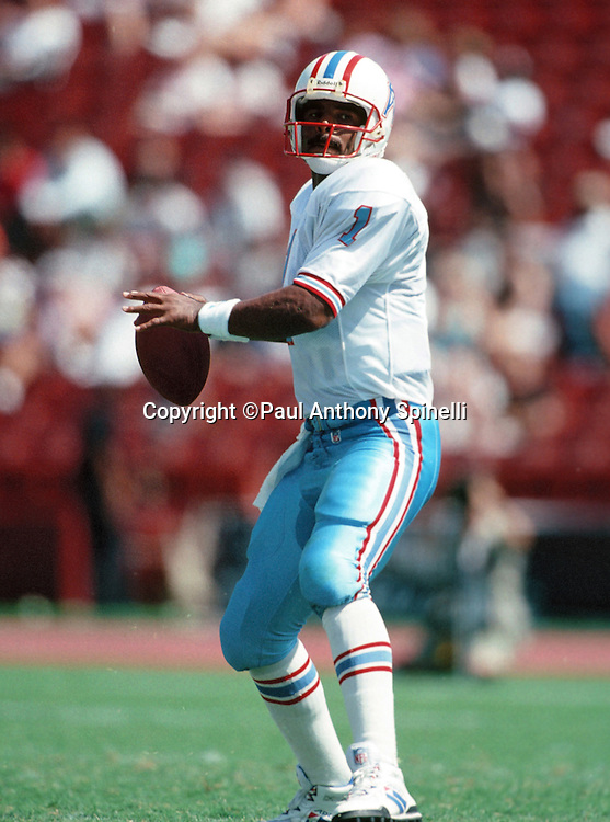 Houston Oilers quarterback Warren Moon (1) throws a pass during the NFL preseason football game against the Los Angeles Raiders on Aug. 29, 1992 in Los Angeles. The Raiders won the game 30-26. (©Paul Anthony Spinelli)
