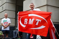 © Licensed to London News Pictures. 10/08/2016. London, UK. The RMT union members stage a protest outside the Department of Transport in London on 10 August 2016 to support the strike action on Southern Rail services and announce Eurostar rail workers will take seven days of strike action in August over work/life balance. Photo credit: Tolga Akmen/LNP