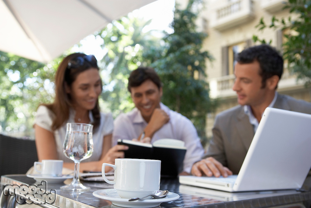 Businesspeople meeting at outdoor cafe