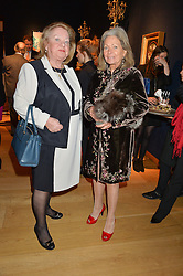 Left to right, ANGELA McALPINE and ANNETTE HOWARD at a party to celebrate the publication of Interiors For Living by Joanna Wood held at Christie's. 8 King Street, St.James's, London on 2nd March 2015.