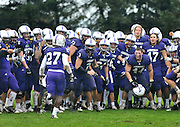 MIKE BRADLEY.The Amherst College football team celebrates a 20-3 victory over Bowdoin College on October 1st.