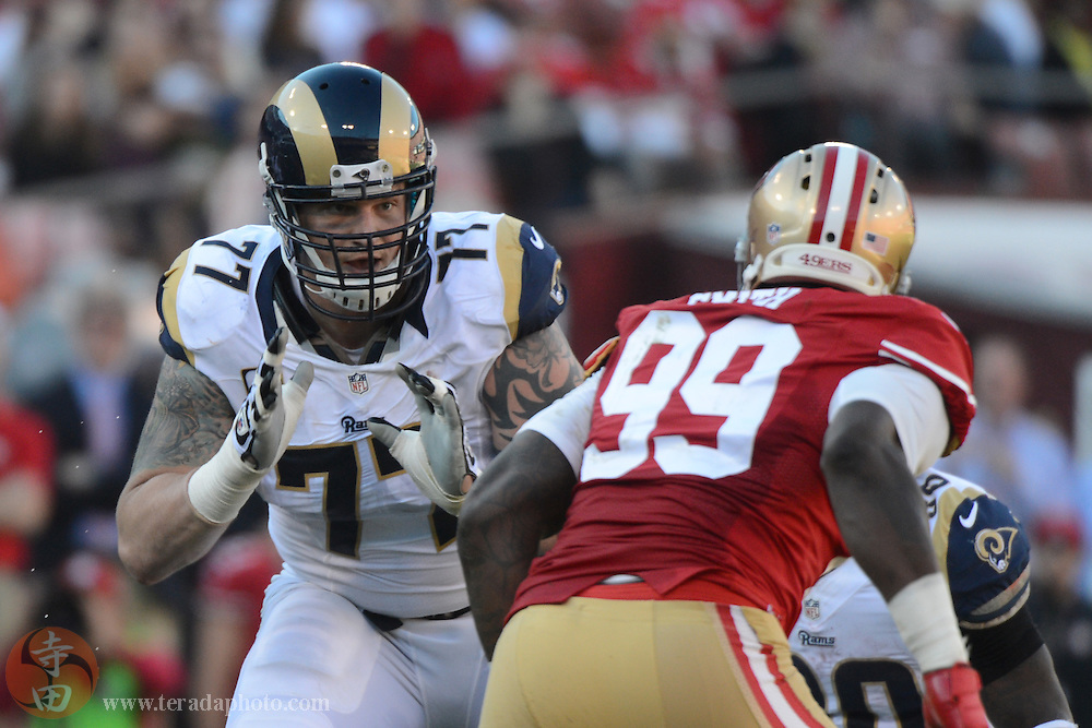 December 1, 2013; San Francisco, CA, USA; St. Louis Rams tackle Jake Long (77) blocks San Francisco 49ers outside linebacker Aldon Smith (99) during the third quarter at Candlestick Park. The 49ers defeated the Rams 23-13.